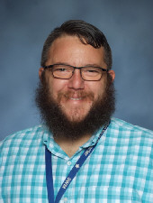 A picture of Mr. Mickley from the 2018-2019 yearbook. He has taken better pictures, but they won't let him pose.