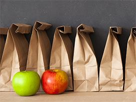 Photo of lunch bags and apples