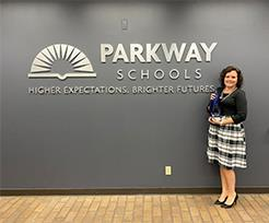 Leah Gonzalez, Parkway's Wellness Coordinator, pictured with award