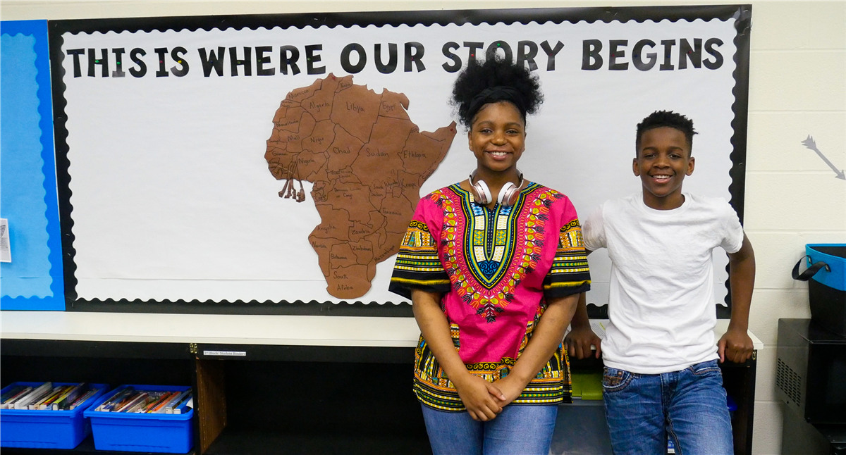 Students standing in front of Africa